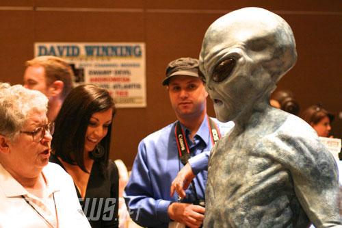 """Fans check out the alien, """"Nesbit""""."""