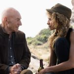 Patrick Stewart as Picard and Michelle Hurd as Raffi