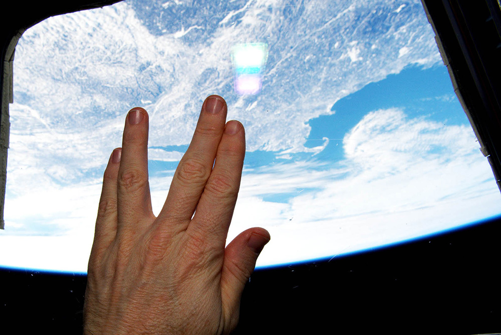 NASA Astronaut Terry W. Virts gives a Vulcan salute