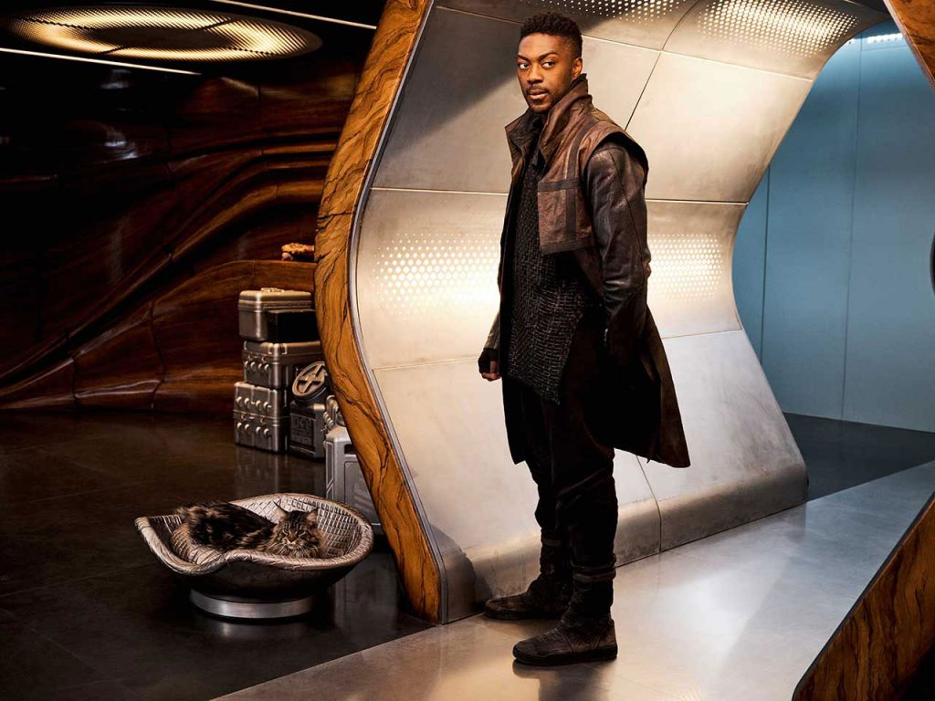"""David Ajala as Cleveland """"Book"""" Booker (and his cat Grudge)"""