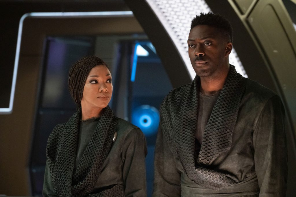 Sonequa Martin-Green as Commander Burnham and David Ajala as Book