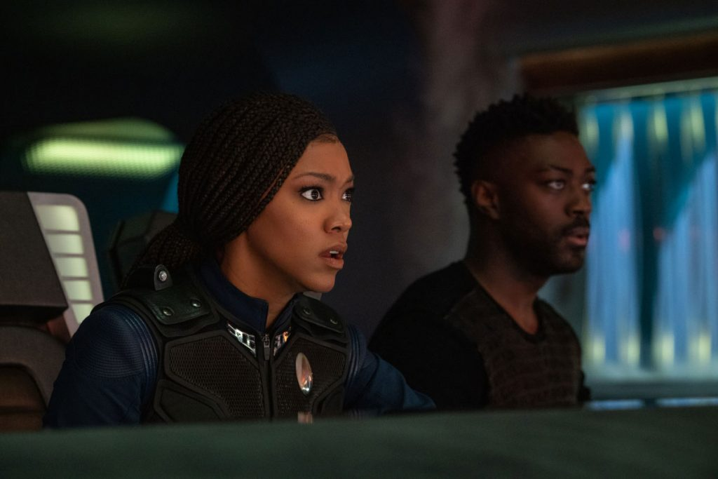 Sonequa Martin-Green as Commander Burnham and David Ajala as Book