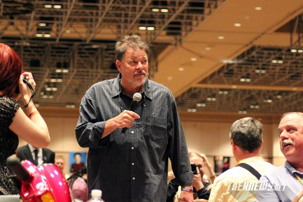 Frakes roams the audience as he answers fan's questions.