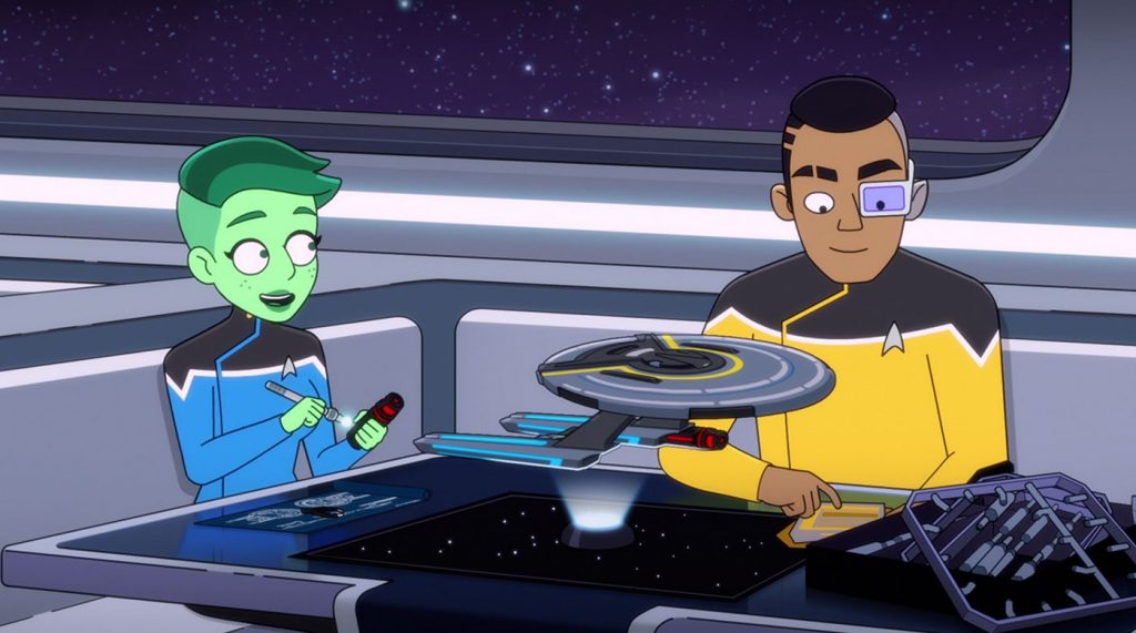 Tendi and Rutherford build a USS Cerritos starship model